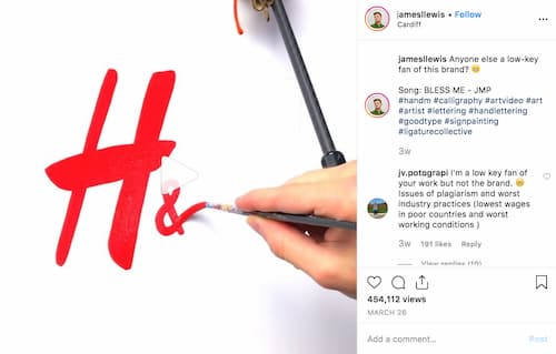 James Lewis shares a video where he uses a paint brush to steady his hand as he works on a visual design project.