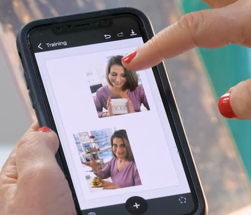 Sue B Zimmerman holds her phone while pointing to the screen that features the Unfold app.