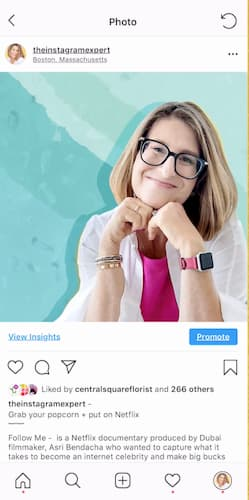 Sue B Zimmerman smiles from her Instagram photo that has a bright blue background.