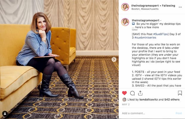 Sue B Zimmerman's Instagram post featuring her sitting on a chair with a yellow backdrop.