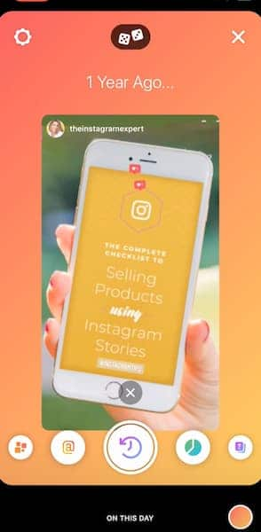 Instagram Story Create mode with an orange background and a photo from one year ago that shows Sue B Zimmerman holding a phone to promote a blog post.