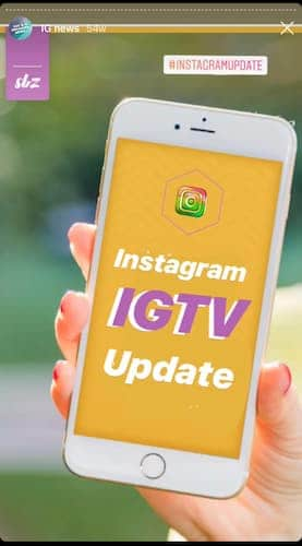 Sue B Zimmerman holds her cell phone which has a yellow screen that says Instagram IGTV update.