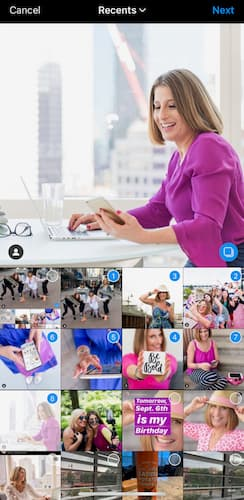 Multiple photos are selected for Sue B Zimmerman's Instagram carousel post with the primary picture featuring her sitting at her desk smile confidently at her computer while wearing a purple blouse.