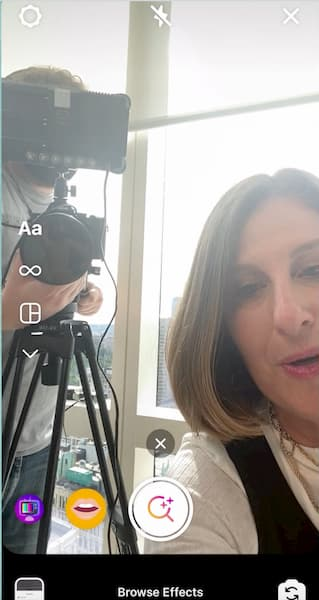 Sue B Zimmerman takes a selfie video as she scrolls to the Instagram Stories filter search option.
