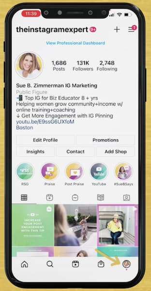 Sue B Zimmerman shows her iPhone and her Instagram profile with an arrow pointing to the tip