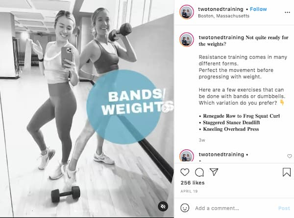Shai and Leah pose for a black and white photo while holding workout weights.